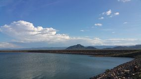 Landscape. Dam water  mountains blue sky Stock Image