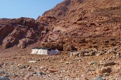 Bedouins houses in Dana Nature Biosphere Reserve landscape near Dana historical village, Jordan, Middle East. Landscape of Dana Biosphere Nature Reserve located stock photography