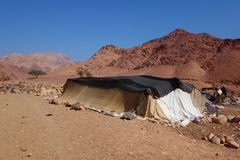 Bedouins houses in Dana Nature Biosphere Reserve landscape near Dana historical village, Jordan, Middle East. Landscape of Dana Biosphere Nature Reserve located stock images