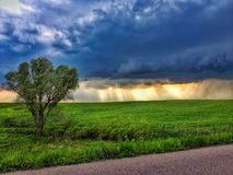 Landscape with dark cloud and beams of the sun Royalty Free Stock Photo