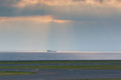 Landscape of dark sky and sea with runway in airport. Landscape of dark sky and sea with runway in airport international Royalty Free Stock Photo