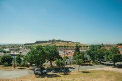 Landscape with the de Santa Luzia Fort on hilltop. Street landscape with white houses and the de Santa Luzia Fort over a hill in the background, on a sunny day stock images