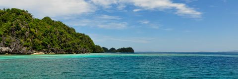 Landscape of deep blue sea and green Island Royalty Free Stock Images