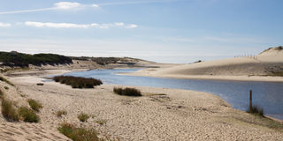 Landscape of desert hills and a lake Stock Photo