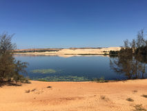 Landscape of desert with the lake in southern Vietnam Royalty Free Stock Photo
