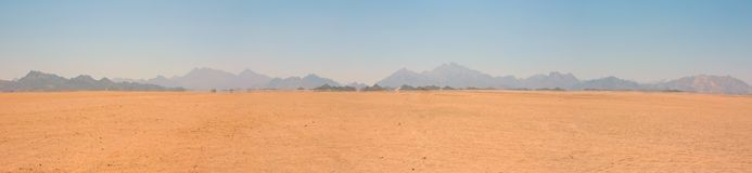 Landscape of the desert to the mountains. Landscape of the sandy desert to the mountains to the sunny weather Royalty Free Stock Image