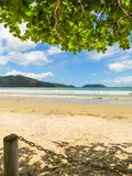 Landscape of deserted beach with island in the background. Landscape of deserted beach with island in the background, in summer day Stock Images
