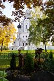 Old Orthodox church with a cross through the autumn foliage. Mos stock photography