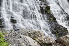 Landscape detail of waterfall over rocks in Summer long exposure Stock Images