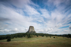 Landscape of Devils Tower National Monument. The striking landscape of Devils Tower from a distance during the day time Royalty Free Stock Photos