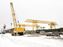 Landscape with different cranes in storage area Stock Photo
