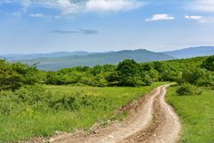 Landscape, dirt road stock images