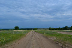 Landscape dirt road. Field forest summer sky clouds Stock Photography