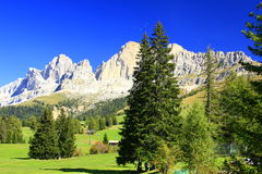 Landscape in the Dolomites. With paragliders above the peaks in South Tyrol, Italy Royalty Free Stock Photos