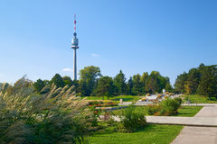 Landscape of Donau park in Vienna, Austria. Landscape of Donau park in Vienna with prominent Donauturm Danube Tower, tallest structure in Austria which has 252 Stock Image