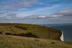 Landscape, dover cliffs. A landscape photo of the dover cliffs, with the lighthouse in the background Royalty Free Stock Images