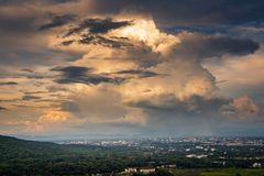 Landscape of dramatic clouds sky over the city at Chiang mai of Thailand., Stormy atmosphere weather situation dramatic at evening. Sunset scene., Natural and royalty free stock photo