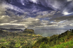 Landscape with a dramatic sky. View over mountains and ocean under a dramatic sky stock images