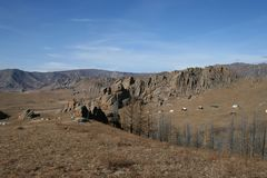 Dry landscape of rocks and trees, Mongolia stock photography