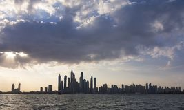Landscape of Dubai city skyline at sunset with clouds. Landscape of the Dubai city skyline at sunset with clouds stock photos