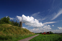 Landscape with a Dutch windmill Stock Photo