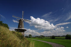 Landscape with a Dutch windmill Stock Image