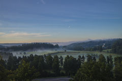 Landscape, an early morning in fog and sunrise Stock Images