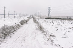 Landscape with an earth empty road between agricultural fields at winter season in central Ukraine Stock Image