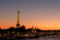 Landscape of Eiffel Tower at golden hour near the river Seine royalty free stock photography