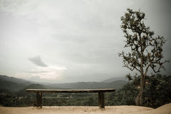 Landscape with empty bench at mountain view point Stock Photography