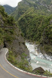 Landscape of empty road, river and steep mountain at Taroko Stock Images