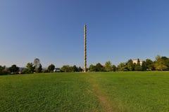 Landscape with `The Endless Column` at Targu-Jiu. Stock Photos