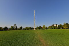 Landscape with `The Endless Column` at Targu-Jiu. The Infinite Column or the Endless Column is a sculpture by the Romanian artist Constantin Brâncuşi, part of Stock Photos