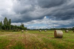 Landscape, environment, summer, overcast, straw bales on harvested field royalty free stock photos