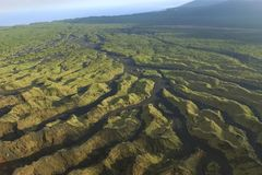 Landscape after the eruption of the volcano. Frozen rivers of magma.  Stock Photos