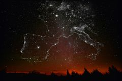 Landscape Europe map constellations of city lights. Forest sunset landscape with projection of Europe map in the form of stars of the constellations of city stock images