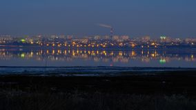 The landscape with the evening lights of the village of Kotovsky, which reflects the Kuyanik in the rhizome. Odessa stock images