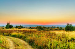 Landscape, evening sky and sunset Stock Image