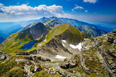 Landscape with Fagaras mountains in Romania. Landscape from the rocky Fagaras mountains in Romania in the summer with Capra lake in the distance Stock Photo