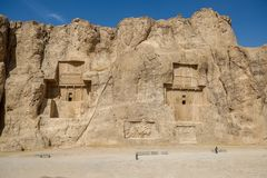 Ancient Naqsh-e Rustam. Fars Province, Iran. Landscape famous landmark of the ancient Naqsh-e Rustam shows large tombs cut high into the cliff face. Fars stock photo