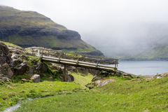 Landscape on the Faroe Islands with bridge Royalty Free Stock Photo