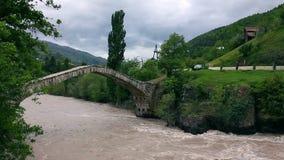 Landscape of fast river over Bridge of Queen Tamara in Georgia stock footage