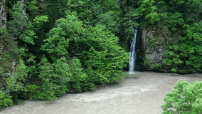 Landscape of fast river and waterfall in Georgia stock video