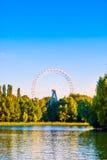 Landscape with ferris wheel Stock Photos