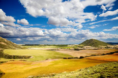 Landscape with field. S and blue sky with clouds stock photos