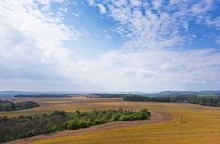 Spring landscape with field, forest and sky Stock Images