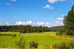 Landscape of the field with great sky and clouds panoramic. Panorama meadow farm fields. Nature in summer. Wheat and mown grass. Big clouds. Rustic panoramic Stock Photography