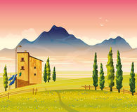 Landscape with field, house and mounains. Landscape with green flowering field, house and mounains on a pink sky background. Summer morning Stock Image