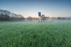 Landscape of field with raised hide Stock Photography