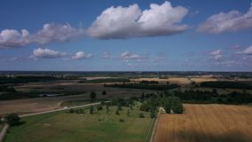 Landscape with fields and cloudy sky. In summer day stock video footage